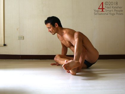 Astavakrasana preparation position, feet crossed with bottom leg on top. Neil Keleher. Sensational Yoga Poses.