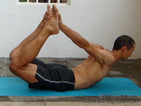 back bending yoga poses, bow pose. For Bow yoga pose, grab the feet behind your back while prone. Bend the spine backwards then lift the feet. Push up with your inner thighs.