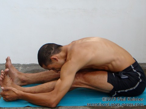 straight leg seated forward fold (knees slightly bent)