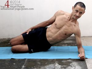 side plank pose, knees and elbows bent, shoulder active, using serratus anterior to push ribcage away from floor.