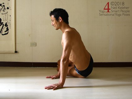 Astavakrasana preparation exercise, note how both hands are on the floor, in line with the bottom knee and foot. Neil Keleher. Sensational Yoga Poses.