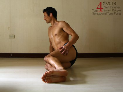 Astavakrasana preparation exercise, note how feet are inline with the knees and hand in this image. To lift your hips you'll have to move your shoulder forwards, ahead of the hand. Neil Keleher. Sensational Yoga Poses.