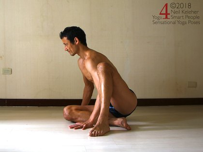 Astavakrasana preparation exercise, sitting with one arm resting against the back of one arm. Neil Keleher. Sensational Yoga Poses.