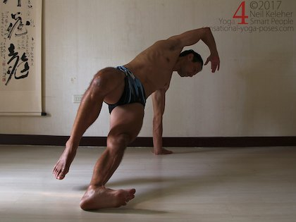 Balancing in side plank, hips back so that front of foot lifts. Neil Keleher. Sensational Yoga Poses.