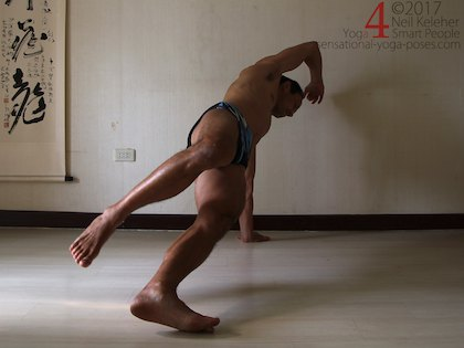 Balancing in side plank, hips forwards so that back of foot lifts. Neil Keleher. Sensational Yoga Poses.
