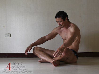 seated slouch to stretch the spinal erectors. Neil Keleher, Sensational Yoga Poses.