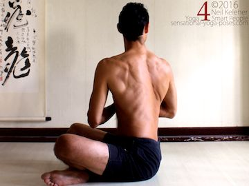 Yoga poses for abs, seated twist with hands in prayer and using abs to turn ribcage relative to pelvis, neil keleher, sensational yoga poses.