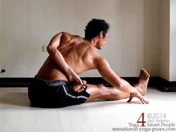half bound lotus seated forward bend (ardha baddha padmo paschimottanasana). Right foot is in lotus and bound with the right hand. Left hand is grabbing the left big toe. Torso is tilted forwards at the hips. Neil Keleher. Sensational Yoga Poses.