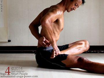 half bound lotus yoga pose