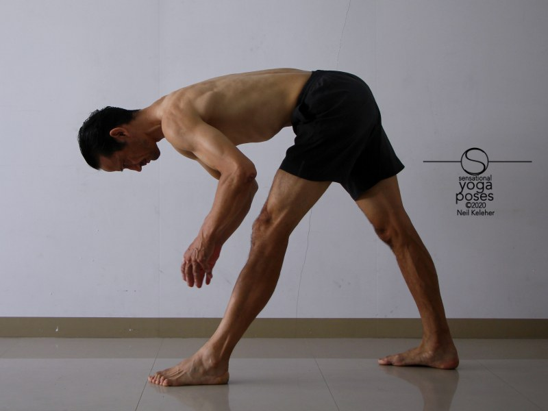 Pyramid pose with hands lifted and hamstrings activated. Neil Keleher, Sensational Yoga Poses.