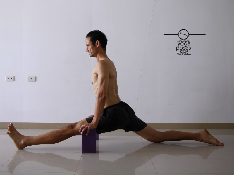 Front to back splits with torso upright and back foot flat on floor. Neil Keleher, Sensational Yoga Poses.