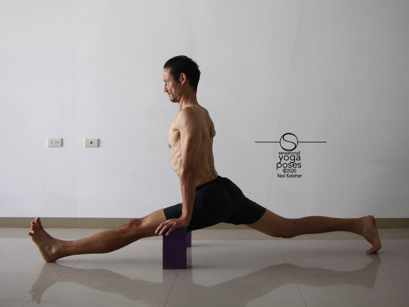 Front to back splits with torso upright and back foot toes tucked and back knee lifted. Neil Keleher, Sensational Yoga Poses.