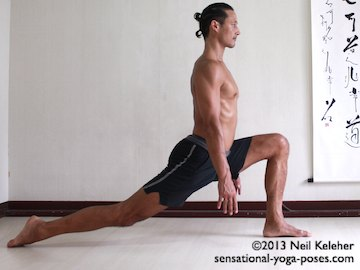 In high lunge back bending yoga pose, reach one leg back while standing. Reach toes back so that top of floor is flat on the floor (or tuck toes under, not shown). Bend the front knee and sink the pelvis down. Separate the feet far enough that the front shin is nearly vertical. Torso upright, sink the hips to stretch the front of the hip. Arms can hang down or then can reach up and back (not shown.) Neil Keleher. Sensational Yoga Poses.