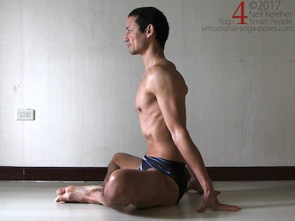 Bound angle pose sitting upright with arms behind for support, Neil Keleher. Sensational Yoga Poses.
