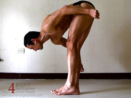 Yoga Poses for abs, standing forward bend with balancing on one floot with both hips actively flexed and abs engaged, neil keleher, sensational yoga poses.