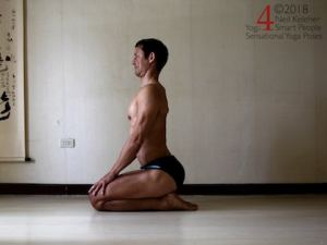 Kneeling spinal back bend. Lift your sacrum so that your pelvis tilts forwards. Feel your lumbar spinal erectors activate and try to carry that activation up the back of your ribcage so that your thoracic spinal erectors also activate. Neil Keleher. Sensational Yoga Poses.