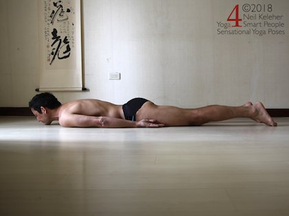 Lying prone in a preparation for locust pose, the idea is to lift the sacrum to activate the sacral multifidus. The pelvis will tilt forwards slight as a result. Neil Keleher. Sensational Yoga Poses.