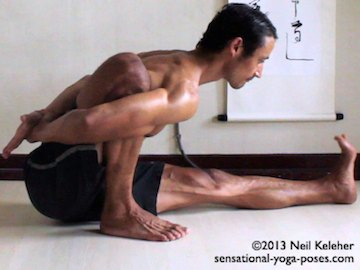 Marichyasana A from side, can see hand grabbing wrist behind back.