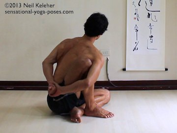 Modified marichyasana position with non-marichyasana foot folded to the inside of the other foor. Torso is twisting away from the marichyasana side. Neil Kelher. Sensational Yoga Poses.
