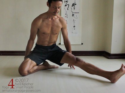 Getting into Janu Sirsasana B seated yoga pose, Using hands to lift the hips and place anus on top of the bent knee heel.