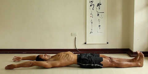 reclining psoas stretch with both arms reaching back. Reclining mountain pose.