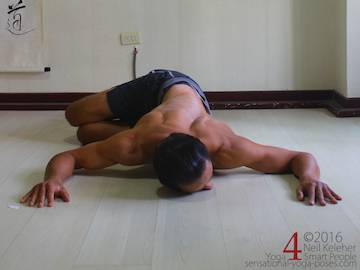 Prone (belly down) spinal twist.	 Neil Keleher. Sensational Yoga Poses.