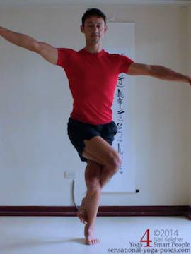 preparation for eagle pose, arms to the side, one arm higher