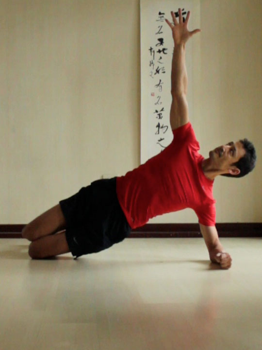 Side Plank or vasisthasana with knees and elbows bent, hips lifted