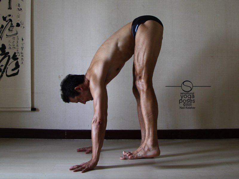 Single leg standing forward bend with other leg pulled forwards using hip flexors. Neil Keleher, Sensational Yoga Poses.