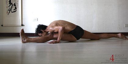 Splits, front to back, while doing a forward bent towards the front leg. Neil Keleher, Sensational Yoga Poses.