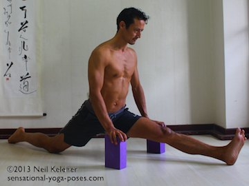 moving into splits with hands on yoga blocks front knee straight back knee on floor