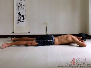 makrasan or crocodile resting posture with forehead resting on hands. Neil Keleher sensationa yoga poses.
