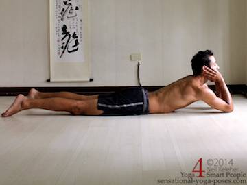 sahajahasa bhujangasan, cobra pose, laying on belly with elbows on the floor and chin on the hands (forearms pointing upwards.) Neil Keleher, sensational Yoga poses.