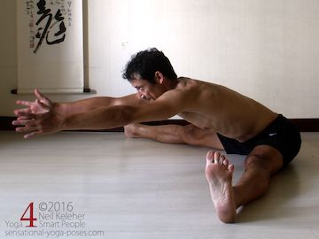 Seated wide leg forward bend with hands lifted and arms reaching forwards. Neil Keleher. Sensational Yoga Poses.
